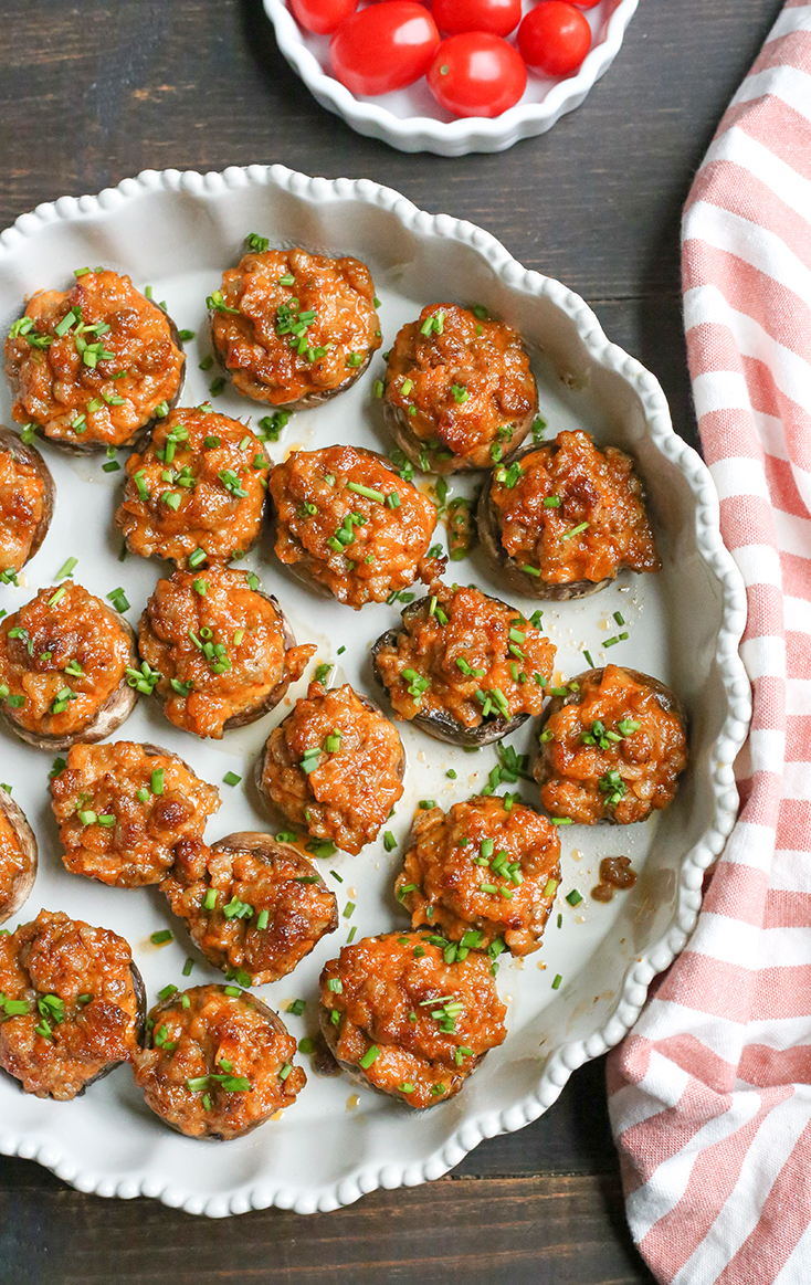 These Chipotle Stuffed Mushrooms are a kicked up appetizer that everyone will love. Sausage, Chipotle Mayo and onion make the best combination. Paleo, Whole30, gluten free and dairy free!