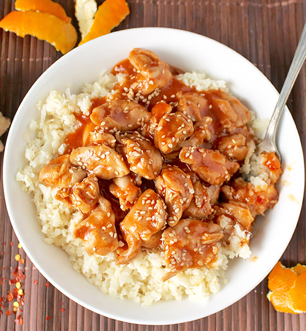 This Paleo Orange Chicken has so much flavor and is made in under 30 minutes! The perfect weeknight meal! Gluten free, dairy free, and lightly sweetened with orange juice.