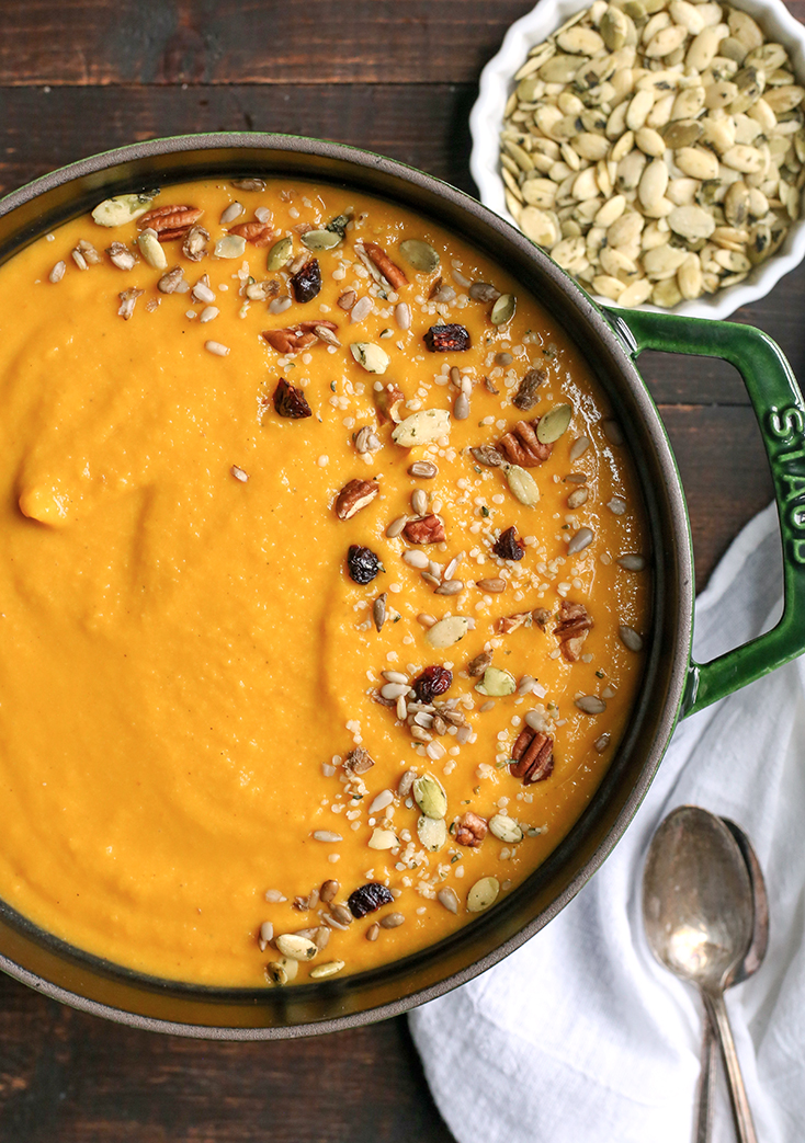 This Paleo Whole30 Squash Soup is creamy, healthy, packed with flavor, and perfect for fall! Butternut squash and pumpkin come together with apples and onions to create a savory soup with just the right amount of sweetness. It's dairy free, and gluten free.