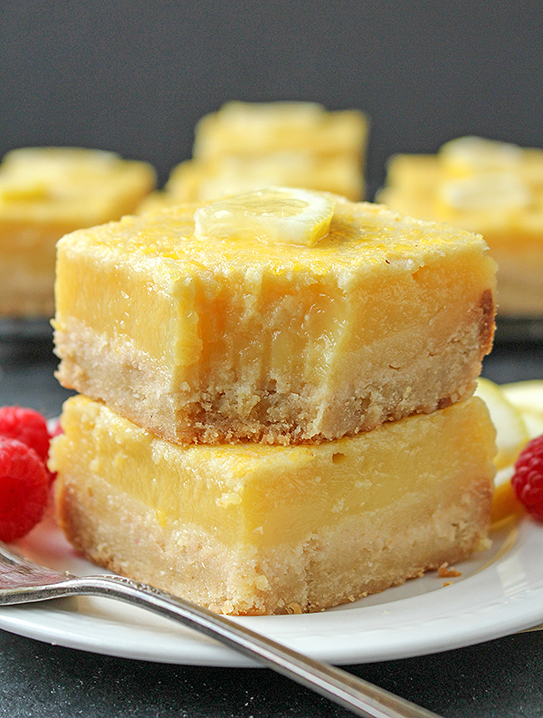 These Paleo Lemon Bars are so full of bright lemon flavor. A simple shortbread crust topped with a creamy, tart lemon filling that is delicious and perfect for spring. They are gluten free, dairy free, and naturally sweetened.