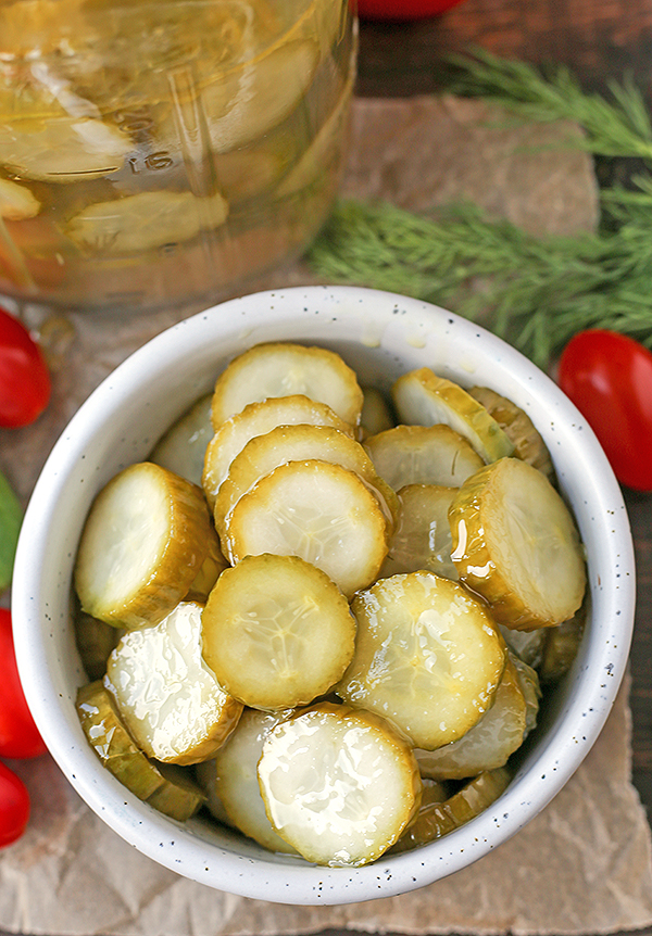 These Paleo Whole30 Dill Pickles are easy and delicious. A healthy alternative to store bought and they take just minutes to make. Crunchy, garlicky, and so good. Made low fodmap with garlic oil!