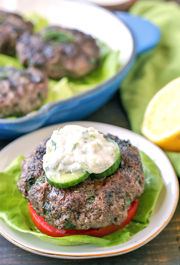 These Paleo Whole30 Grilled Gyro Burgers are easy to make and packed with so much flavor! The perfect burger to make for your grill out! Low carb, keto, and low fodmap and everyone will enjoy them!