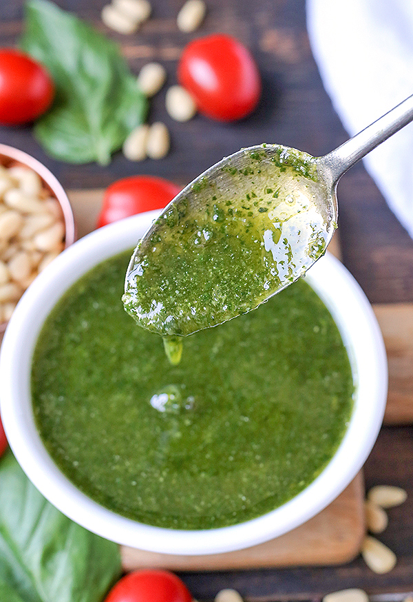 This Paleo Whole30 Basil Pesto also happens to be low fodmap, but still big on flavor! Made with fresh basil, pine nuts, and garlic oil, it is easy and so delicious! Gluten free, dairy free, and low carb.