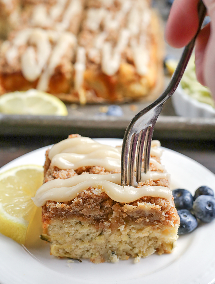 This Paleo Lemon Zucchini Coffee Cake is tender, moist, and has the best crumb topping! It's gluten free, dairy free, and is sure to become a new favorite!