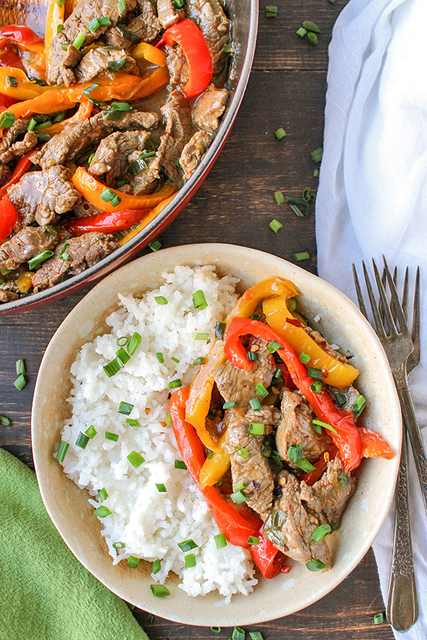This Paleo Whole30 Easy Pepper Steak is quick and flavorful! Tender beef and thinly sliced peppers covered in a savory sauce. Gluten free, dairy free, and low FODMAP.