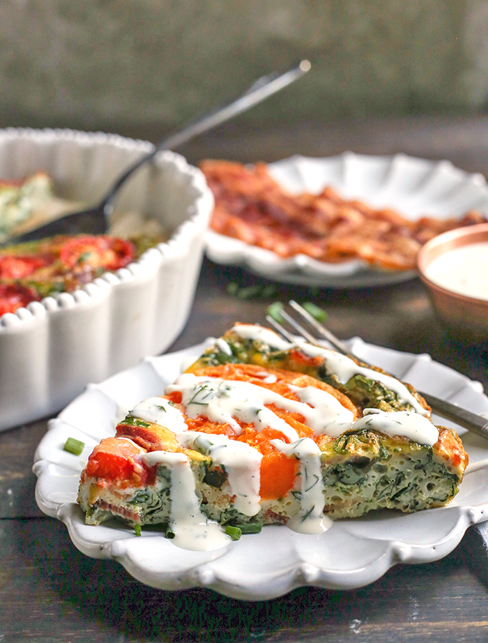 This Paleo Whole30 BLT Breakfast Bake has all the flavors of a BLT, but packed in a delicious egg bake. Crispy bacon, baby spinach, and fresh tomatoes combine for a tasty, filling breakfast. Gluten free, dairy free, low carb, and low fodmap.