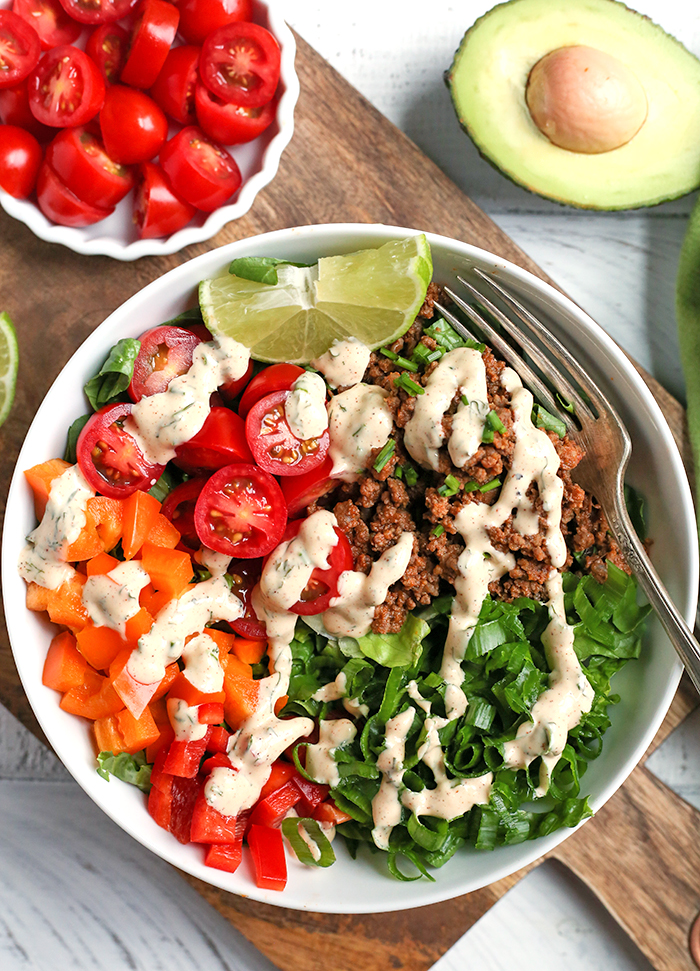 This Paleo Whole30 Taco Salad is an easy, filling, healthy meal that everyone will love. Seasoned meat and loads of veggies make for a complete meal and it's gluten free, dairy free, low fodmap, and low carb.