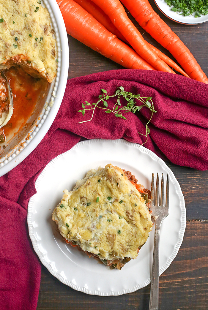 This Paleo Whole30 Shepherd's Pie is comfort food that is perfect for chilly days. A layer of lamb and veggies is topped with creamy mashed potatoes and baked together for one hearty meal. Everyone will love it! It's gluten free, dairy free, and low fodmap.