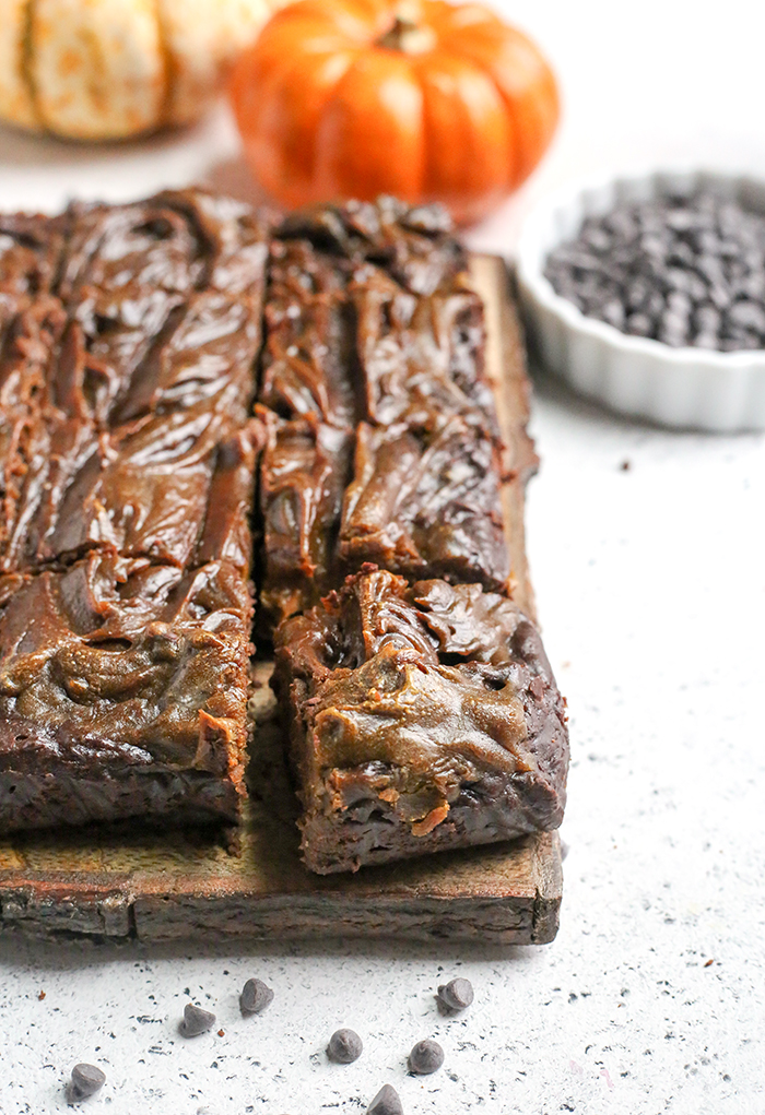 These Paleo Vegan Pumpkin Swirl Brownies are so rich, delicious, and easy to make! They are gluten free, dairy free, egg free, vegan, nut free, and naturally sweetened.