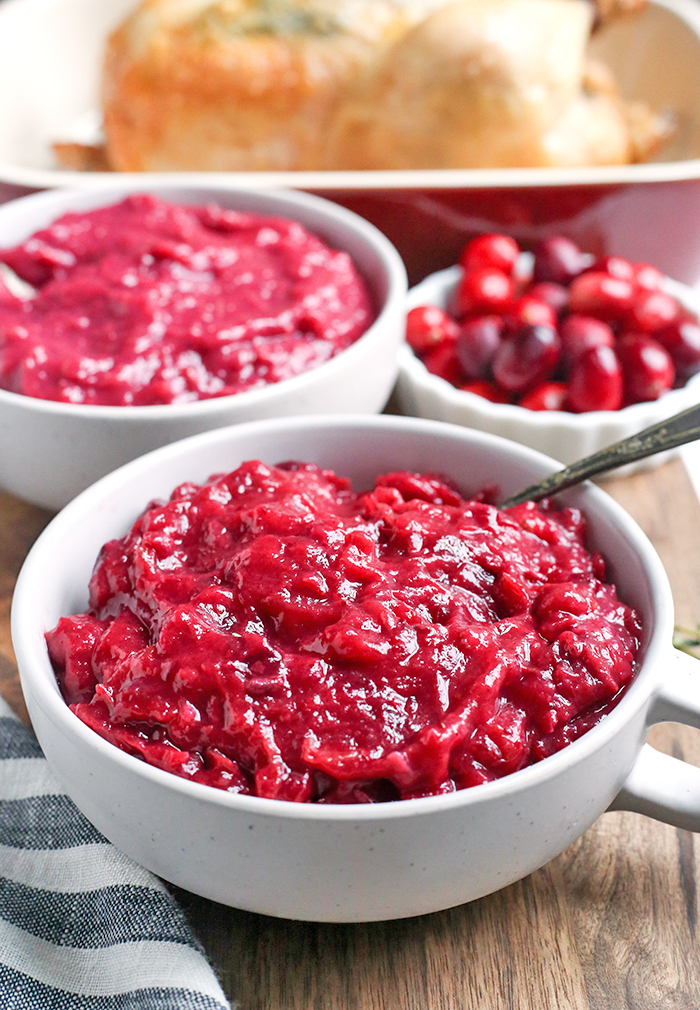 This Paleo Whole30 Easy Cranberry Sauce comes together quickly and is so tasty. Made with just 3 ingredients and sweetened only with fruit. This is a must for your Thanksgiving table!