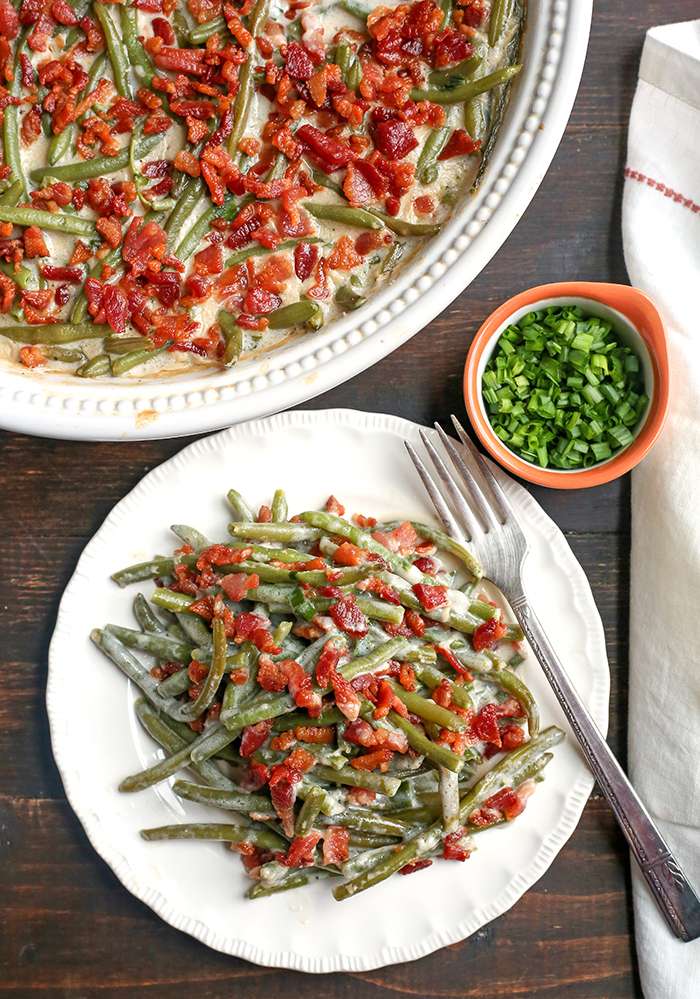 This Paleo Low FODMAP Green Bean Casserole is easy to make, full of flavor, and a healthy side dish. The green beans are covered in a creamy sauce and topped with bacon. Gluten free, dairy free, and Whole30.