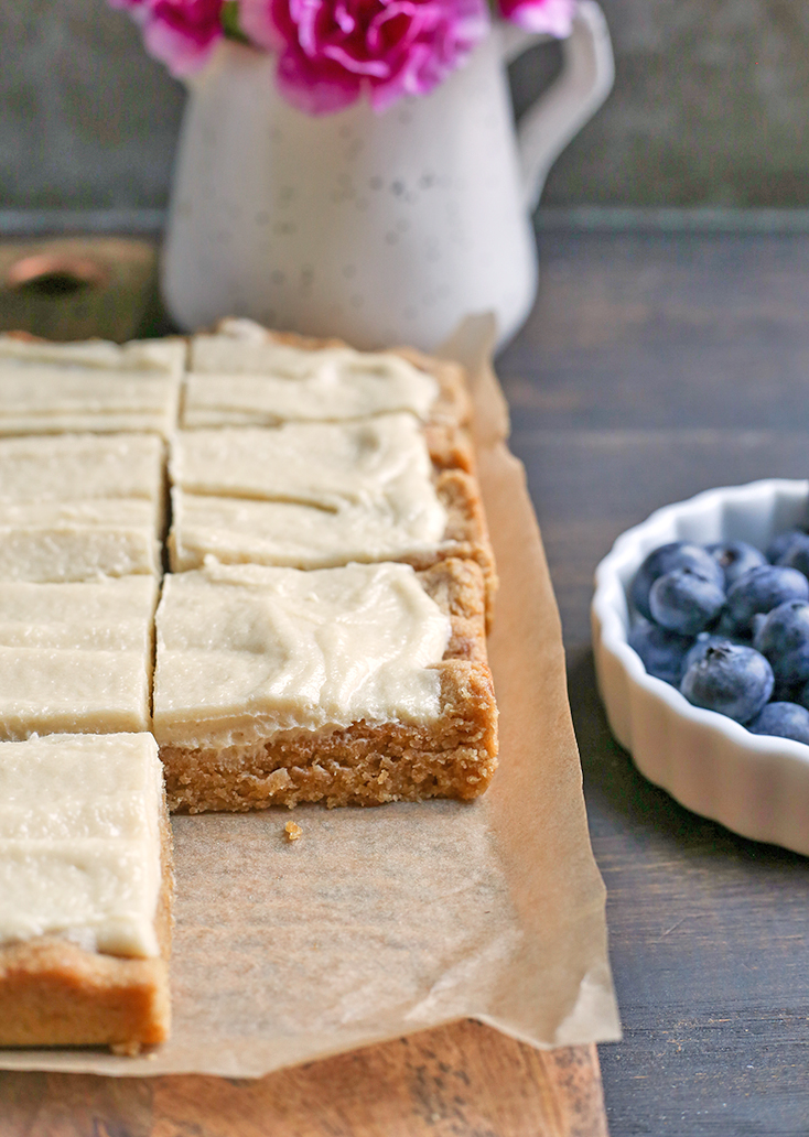 These Paleo Sugar Cookie Bars are so easy to make and have all the same flavors as a sugar cookie. Gluten free, dairy free and naturally sweetened.