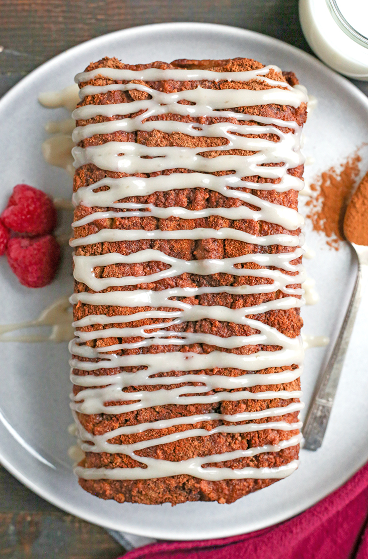 This Paleo Cinnamon Roll Quick Bread is so easy to make and tastes incredible! Tender cake with a sweet cinnamon swirl and drizzled with a thick glaze. Gluten free, dairy free, and naturally sweetened.