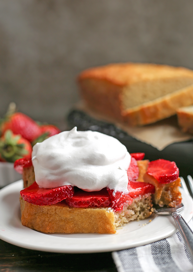 This Paleo Strawberry Shortcake Poundcake is easy to make and a great spring dessert. Tender cake covered in sweet strawberries topped with whipped topping. It's gluten free, dairy free, nut free and delicious!