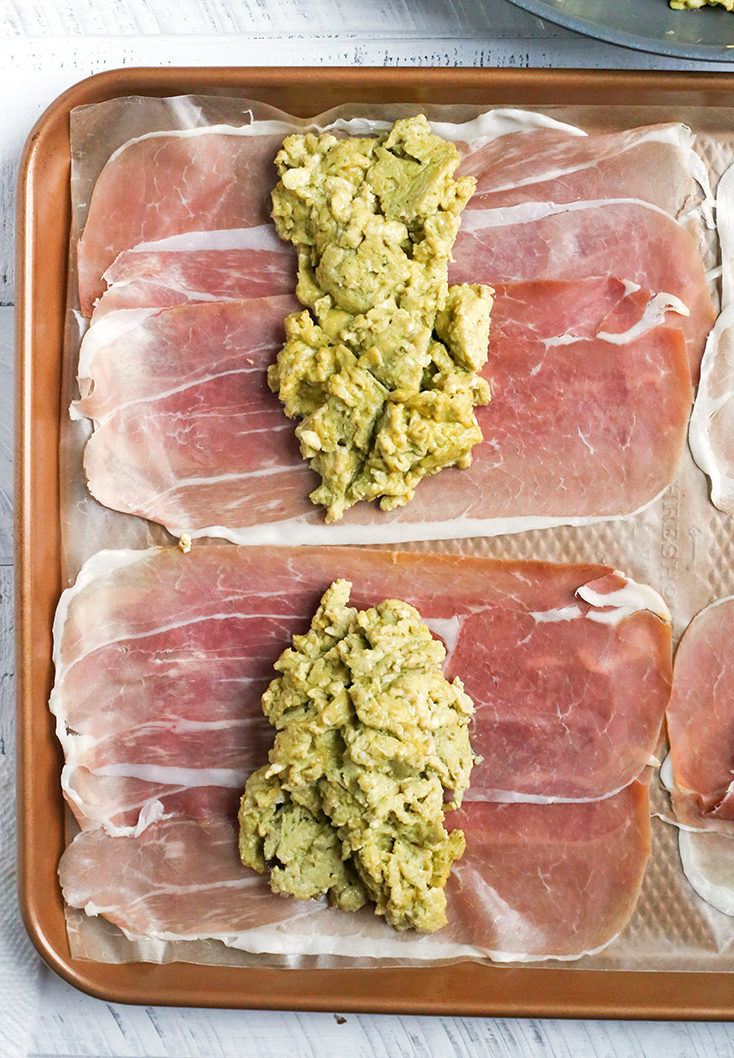 These Paleo Whole30 Pesto Prosciutto Egg Wraps are a fun, handheld breakfast. Tender cooked eggs wrapped in crispy proscuitto making a healthy burrito. They are gluten free, dairy free, low carb and low FODMAP.