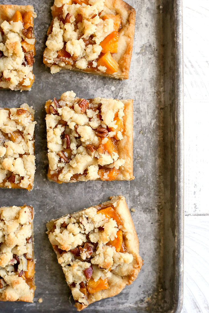 These Paleo Peach Pie Crumb Bars have all the flavor of the classic pie, but made was easier! They are vegan, gluten free, dairy free, egg free, and naturally sweetened.