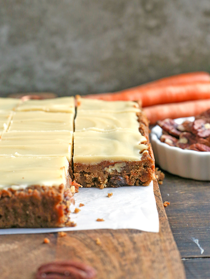 These Paleo Vegan Carrot Cake Bars are easy to make and so tasty. Moist, spiced just right, and topped with a delicious  frosting. Gluten free, dairy free, egg free, and naturally sweetened.