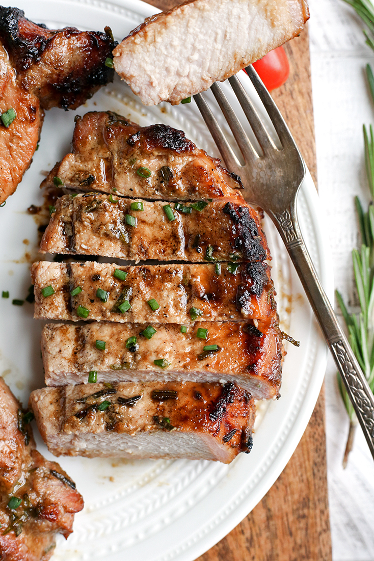 These Paleo Whole30 Dijon Rosemary Pork Chops are easy to make and so flavorful. Perfect for the grill, but still delicious cooked indoors. They're dairy free, low carb, low FODMAP and sugar free.