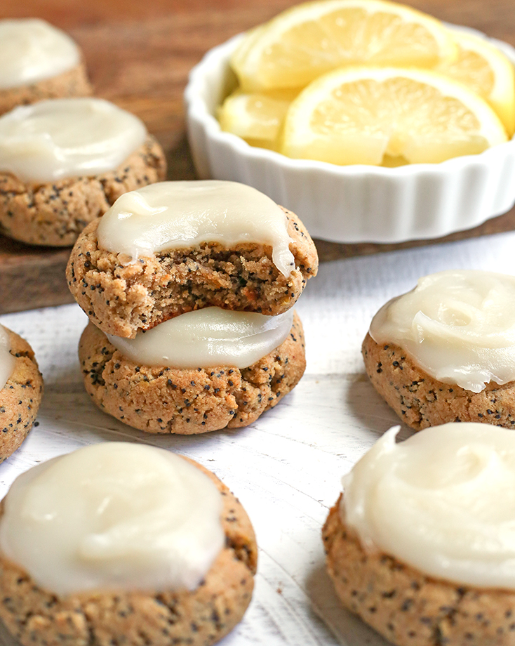 These Soft Paleo Lemon Poppy Seed Cookies are easy to make and so delicious! A tender cookie topped with a sweet and tangy glaze. Gluten free, dairy free, and naturally sweetened.