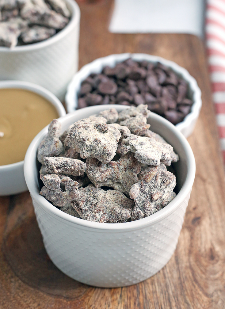 These Paleo Nut-Free Muddy Buddies (also known as Puppy Chow) are easy to make and so delicious. A chocolate and SunButter mixture poured over sunflower seeds and dusted with maple sugar. They are gluten free, dairy free, vegan, and naturally sweetened.