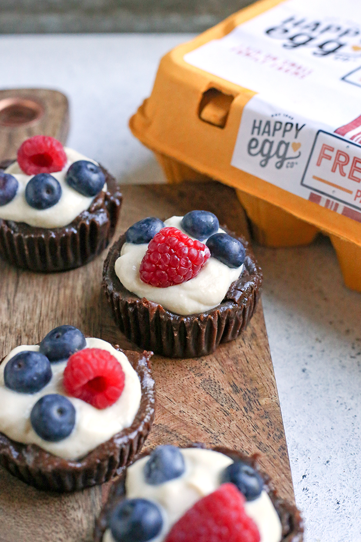 These Paleo Pudding Filled Brownie Bites are such a fun dessert. An easy brownie is made in a muffin pan and filled with dairy free pudding and topped with berries. They're dairy free, gluten free, low FODMAP, and naturally sweetened.