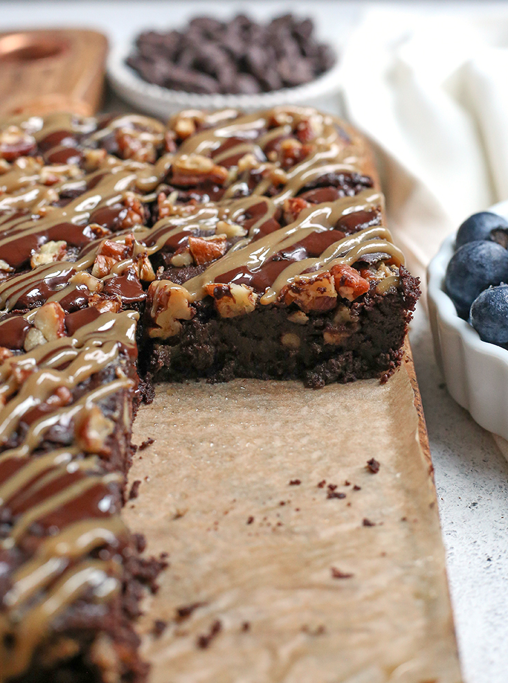 These Paleo Turtle Brownies have a rich, chocolate base, layered with caramel, topped with pecans and chocolate chips and drizzled with more caramel. A decadent treat that is gluten free, dairy free, and low FODMAP.