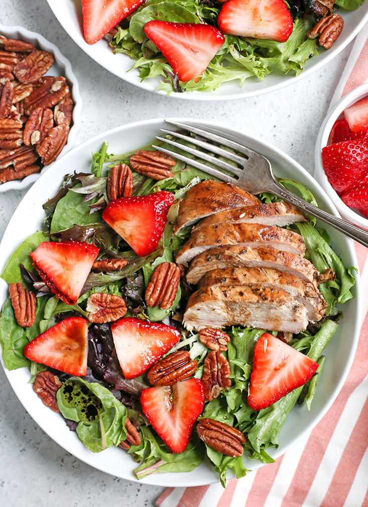 This Paleo Whole30 Balsamic Chicken Strawberry Salad is an easy meal filled with fresh berries and flavorful chicken. A homemade dressing that doubles as the marinade keeps it simple. It's gluten free, dairy free, and low FODMAP.