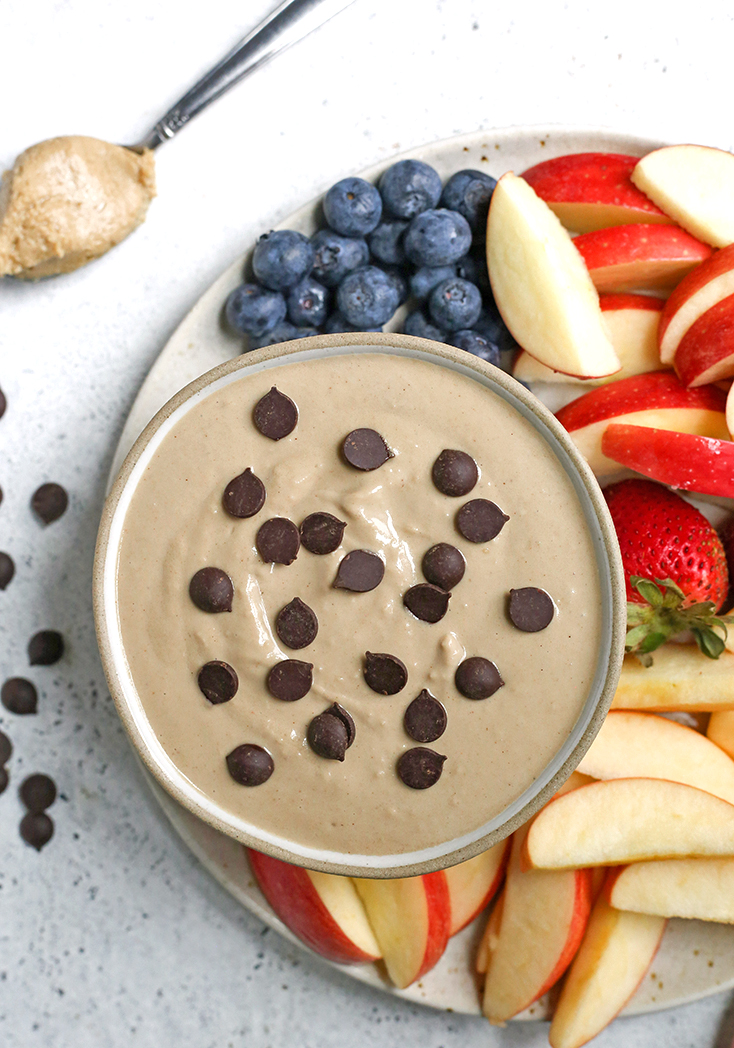 This Paleo SunButter Yogurt Fruit Dip is simple to make and so delicious. SunButter and dairy free yogurt combine to make a creamy dip that is perfect for pairing with fruit. It's vegan, naturally sweetened, and low FODMAP.