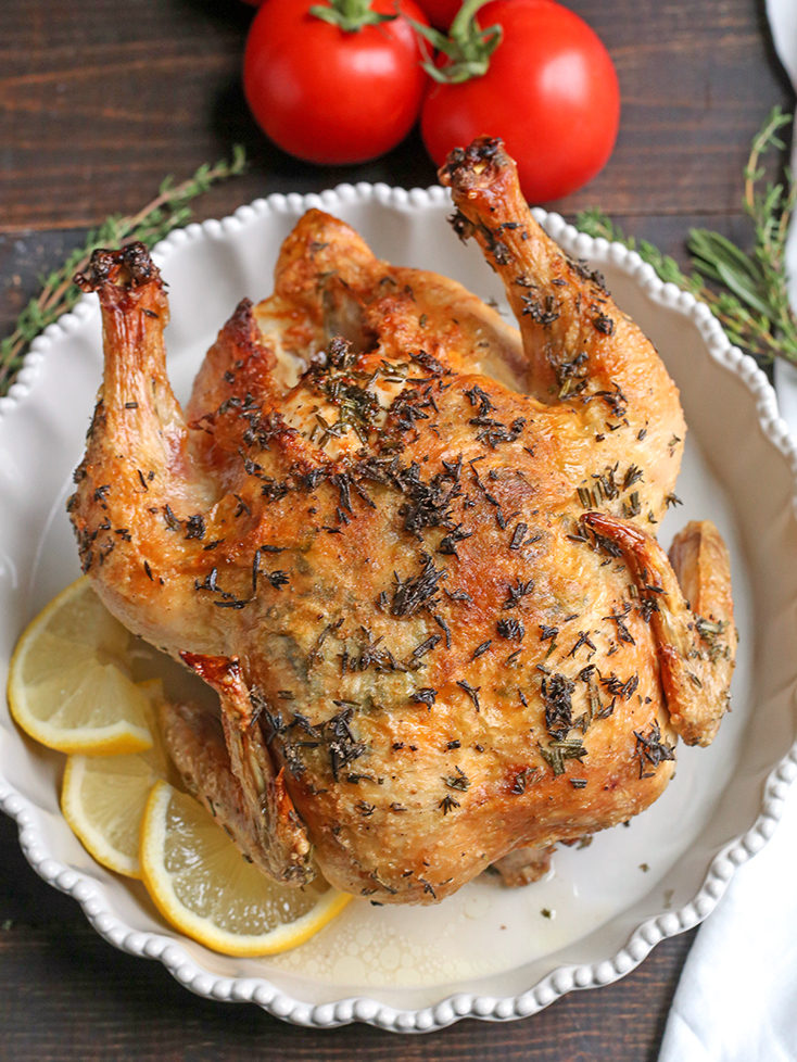 This Paleo Whole30 Air Fryer Whole Roasted Chicken is easy and incredibly delicious! Fresh herbs add great flavor and it has the best crispy skin. It's gluten free, dairy free, low carb and low FODMAP.