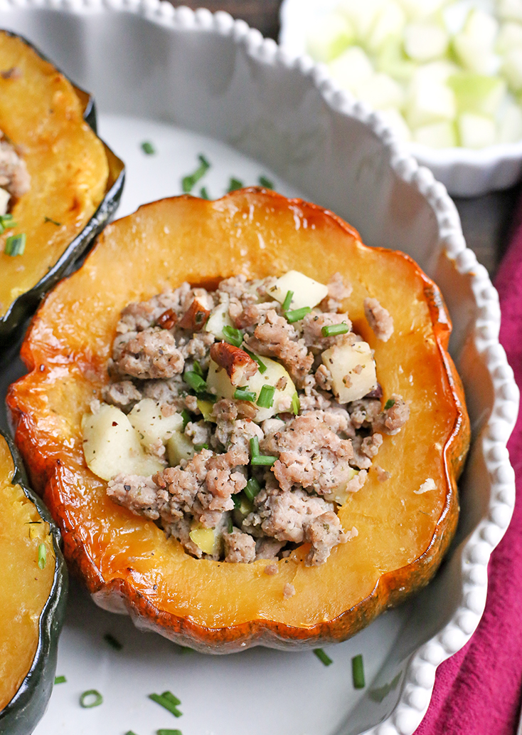 This Paleo Whole30 Sausage Stuffed Acorn Squash is filling, flavorful, and healthy. A homemade sausage, apples, and pecans stuffed into a tender acorn squash. Gluten free, dairy free, and can be made low FODMAP.