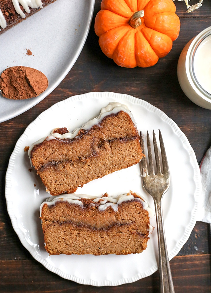 This Paleo Pumpkin Cinnamon Roll Bread is so easy to make and tastes incredible! Tender cake with a sweet pumpkin spice swirl and drizzled with a thick glaze. Gluten free, dairy free, and naturally sweetened.
