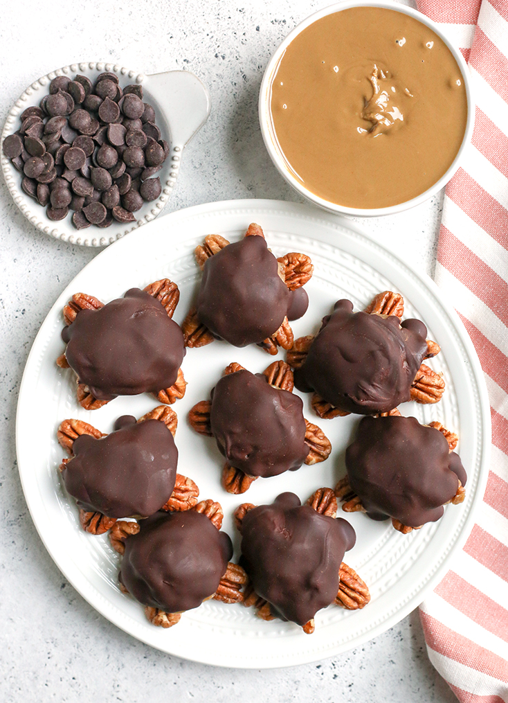 These Paleo Vegan Pecan Turtles are simple to make, no-bake, and so tasty. A healthy version of the classic candy. Sweet caramel on top of crunchy pecans and topped with chocolate. They are gluten free, dairy free, low FODMAP and naturally sweetened.