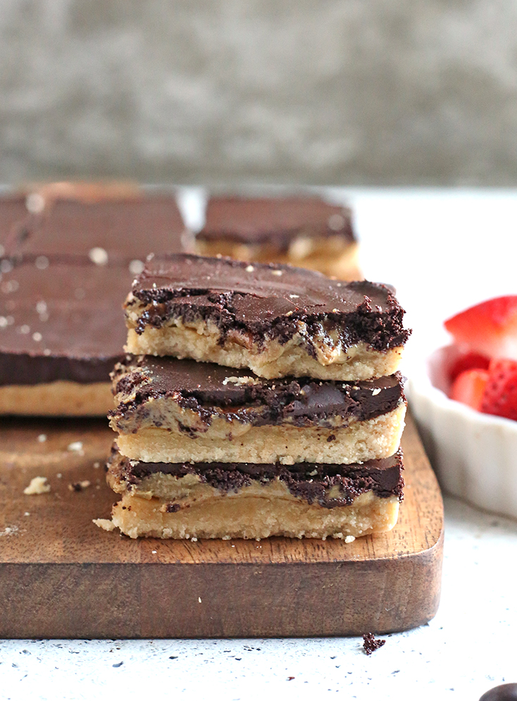 These Paleo Nut Free Tagalong Bars are simple to make and so delicious. A shortbread crust, sweet SunButter layer, and topped with chocolate. They are vegan, gluten free, dairy free, and naturally sweetened.
