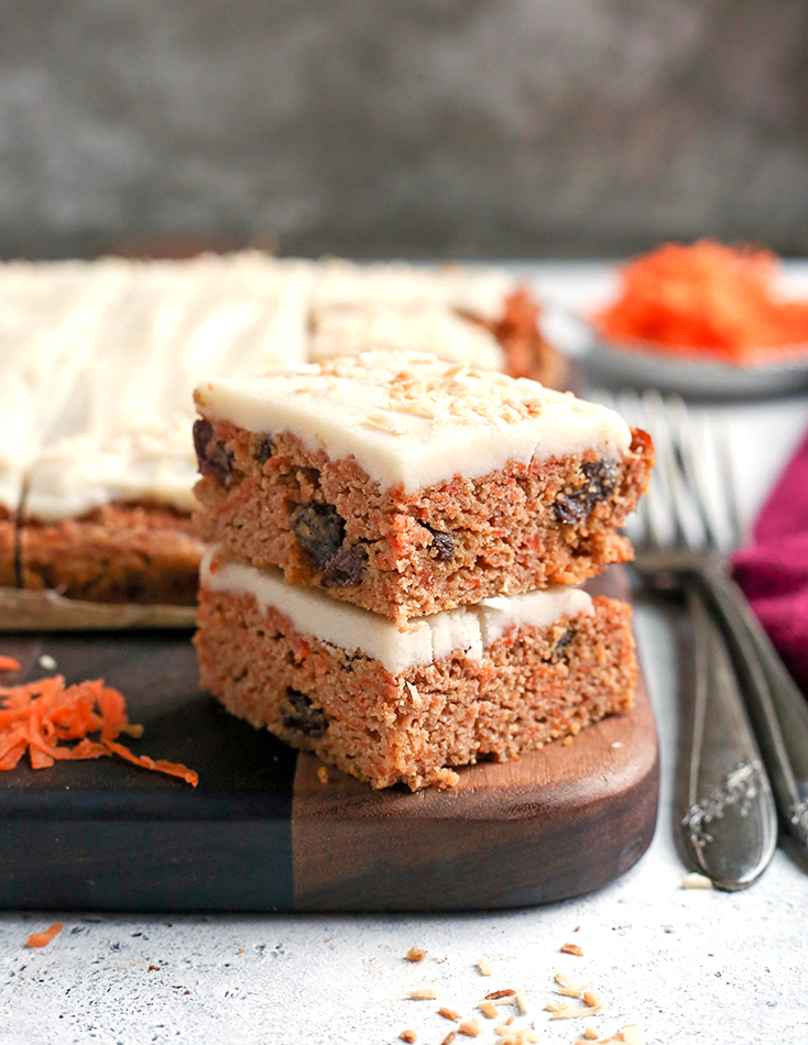 nut free carrot cake bars, stacked with forks on the side
