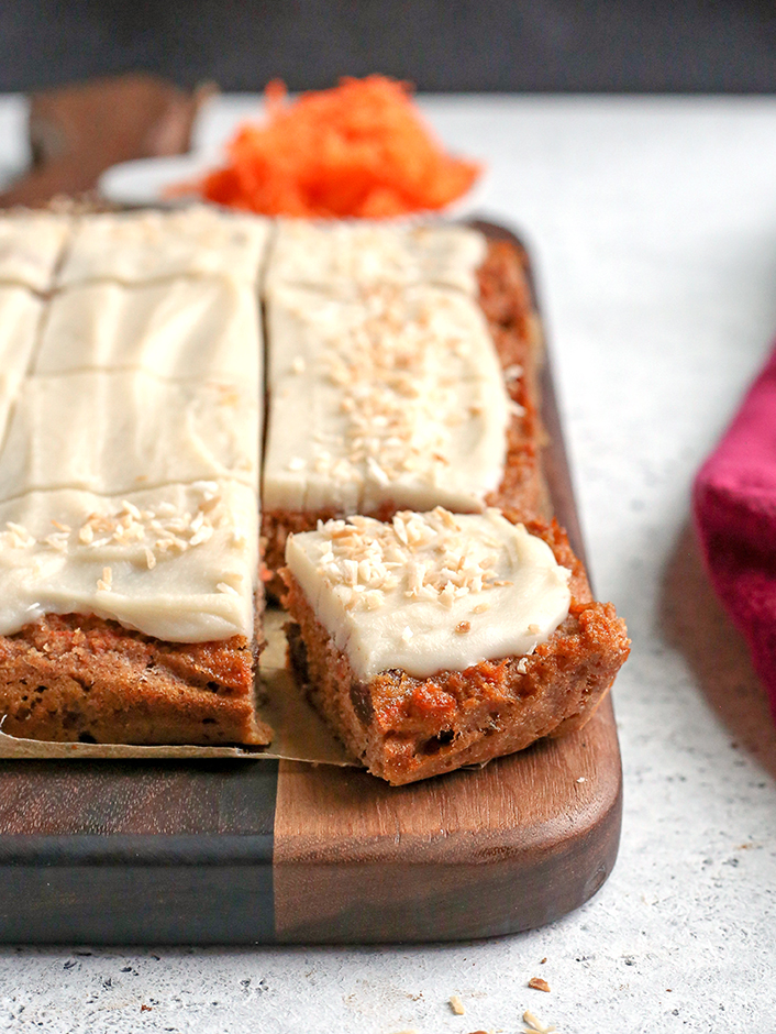 paleo nut free carrot cake bars showing a piece cut out