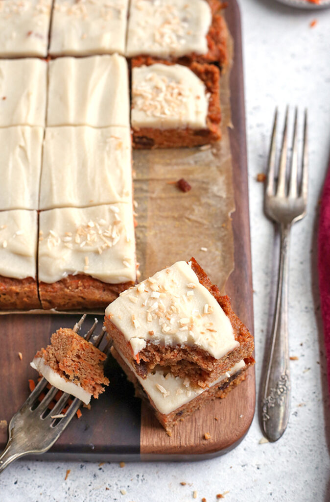 paleo nut free carrot cake bars with a bite shown out of them