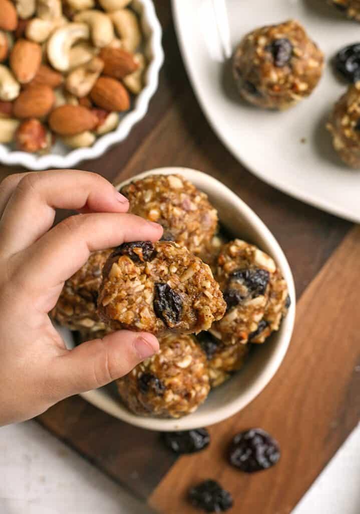 tart cherry granola bites, hand taking one