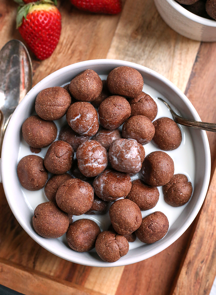 nut free paleo cocoa puffs in a bowl with almond milk