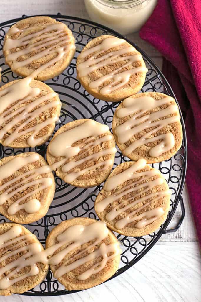 paleo cinnamon roll cookies with glaze on them