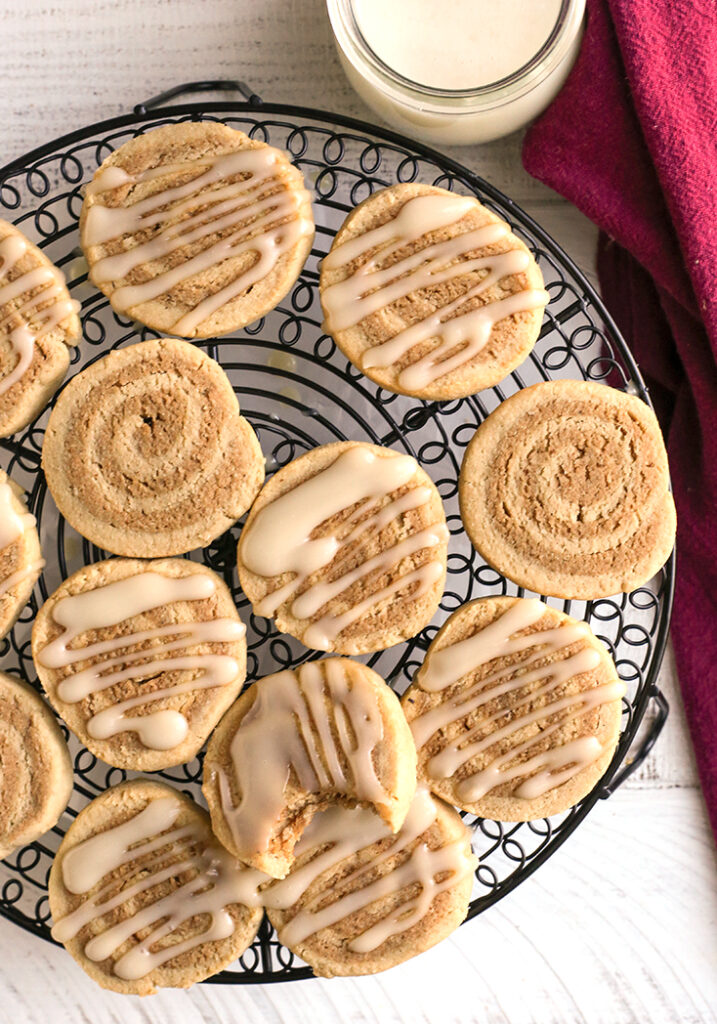 top shot of paleo cinnamon roll cookies. Some with glaze and some plain