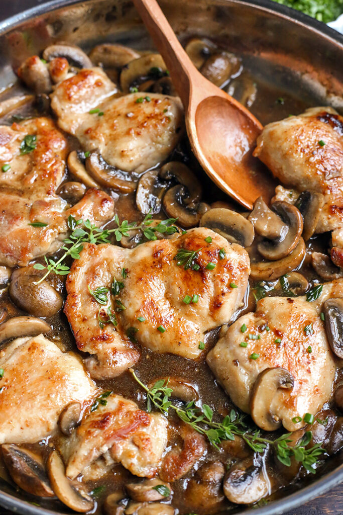 creamy paleo mushroom chicken in the pan with fresh thyme