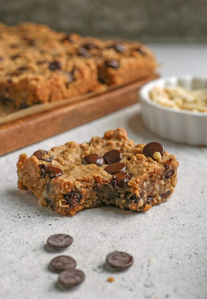 paleo oatmeal cookie bar, bite taken out of it