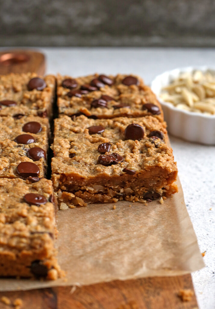 paleo oatmeal cookie bars, one removed to show the inside