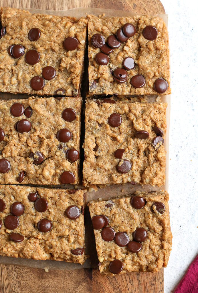 paleo oatmeal cookie bars, cut with chocolate chips on top