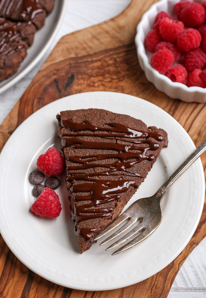 a paleo chocolate scones on a plate with a fork