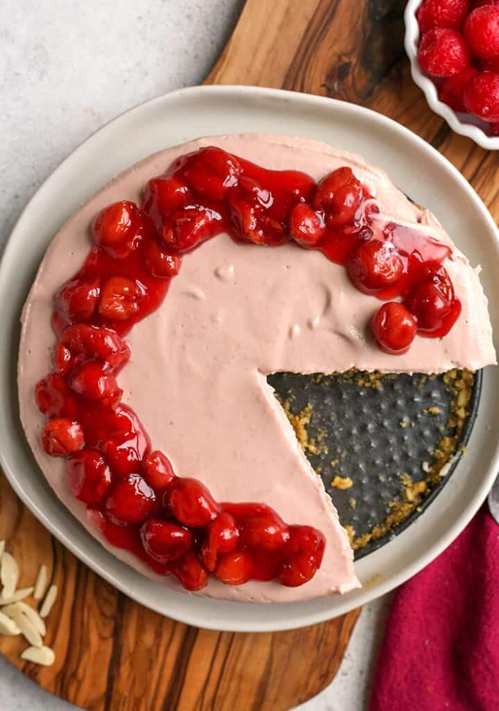 top shot of paleo vegan cherry cheesecake. One slice missing.