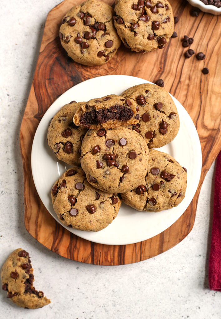 a plate of paleo vegan brownie stuffed chocolate chip cookies