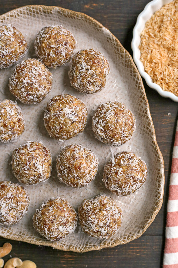 paleo vegan coconut cashew bites on a plate