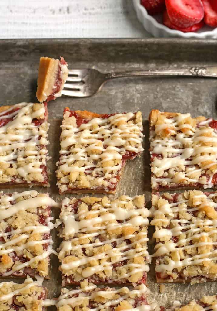 paleo strawberry crumb bars, cut on a pan