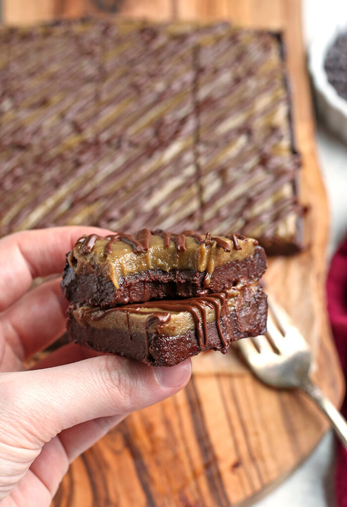 hand holding two paleo vegan buckeye brownies